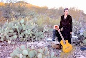 Maggie and her guitar in the desert